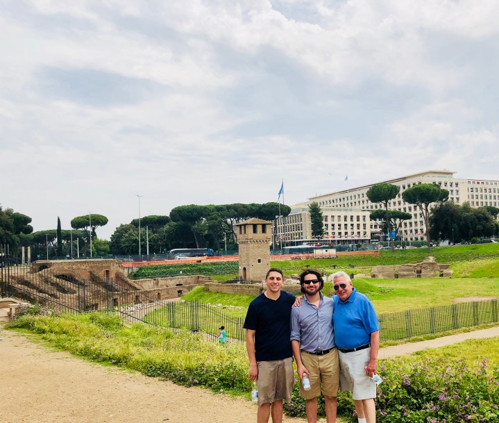 My dad and brothers with what's left of Circus Maximus in the background
